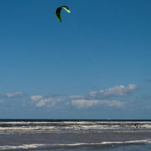 Kitesurfing on a blue sky background